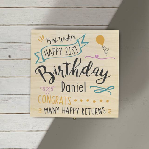 """Personalise this wooden photo cube with a name of up to 15 characters and their age. A perfect gift to store all those photos from their Birthday! Please note as it is a natural wood product, colour and grain may slightly differ from box to box. The box is 11x11cm and holds four 3"""" x 3"""" photos."""