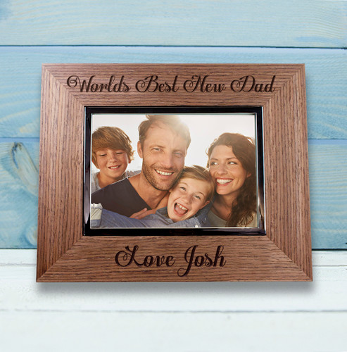 """Made from Walnut Veneer this photo frame is the perfect gift for a new dad. You are able to personalise this frame with his child's name.  To finish this gift off fill the frame with an adorable picture, to remind dad of a special moment.  Holds photos measuring 3.5 x 5"""""""