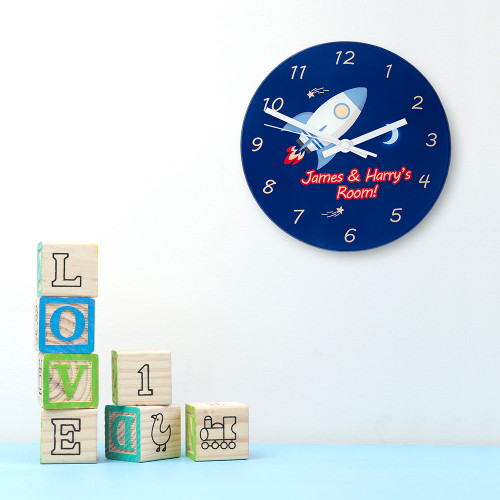 If they love all things space and their favourite person is Tim Peake, this is the clock for them!   In a dark midnight blue and with a rocket taking centre stage this clock will be a wonderful addition to their room.  This 20cm glass wall clock is great to hang in their bedrooms.  Personalise with a name up to 15 characters.   The word 'Room' comes as standard text.