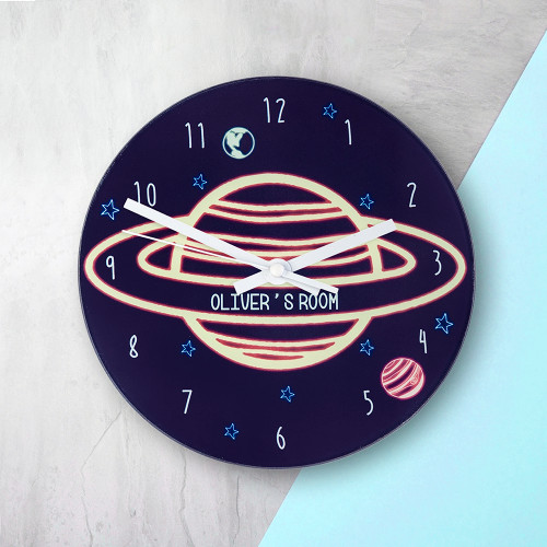 If they love all things space and their favourite person is Tim Peake, this is the clock for them!   In a dark midnight blue and with Neptune taking centre stage this clock will be a wonderful addition to their room.  This 20cm glass wall clock is great to hang in their bedrooms.  Personalise with a name up to 15 characters.  The word 'Room' comes as standard text.