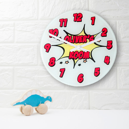 Wham! Bam! Pow!   Comic book fans will be ecstatic at the prospect of having this wonderful clock hanging on their wall.  This 20cm glass wall clock is great to hang in their bedrooms.  Personalise with a name up to 15 characters.   The word 'Room' comes as standard text.