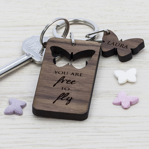 Walnut wood keyring with cut out butterfly. Made from Walnut Wood Personalise with name Cut out design The word's 'You are free to fly' come as standard