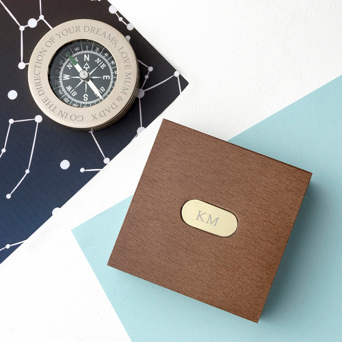 "High quality brass paperweight compass, presented in a fine mahogany stained wooden box with monogrammed brass plate. Great as a gift to give someone who is travelling to remind them of you on their adventures, and to help them find their way home Message on compass shown in photo says: ""So you can always find your way back home. Love Anna"" Personalise your compass with this or any other message up to 65 characters The base of the brass compass is lined with black felt with the interior of the wood box being a green felt."