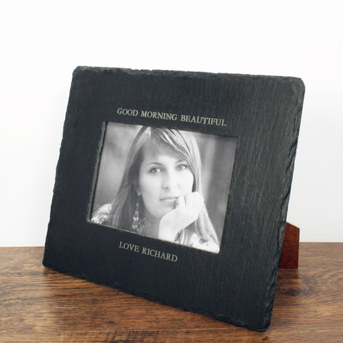 Natural slate photoframe with a window cut into the stone to display your photo Personalised with up to 2 messages, one above and one below the frame. Dimensions: 24cm x 19cm