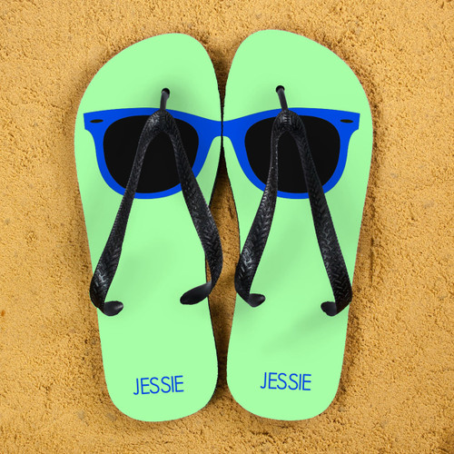 Sunglass style flip flops Can be personalised with name. The straps and soles of the flip flops are black. Available in several colourways  Size Guide: Large - 10 - 12 Medium - 7 - 9 Small - 4 - 6