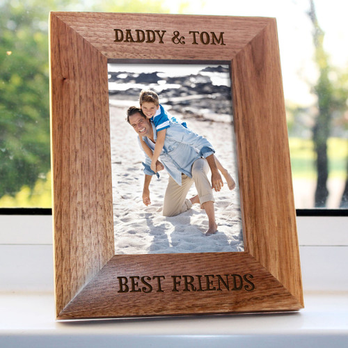 """Personalised oak photo frame with a child's name, friends' names, or a special message Top of photoframe can be engraved as desired  'BEST FRIENDS' is engraved as standard. Dimensions: 4""""x6"""""""