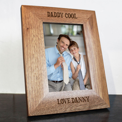 """Personalised oak photo frame which can be personalised with his child's or children's name(s). The words DADDY COOL come as standard Dimensions: 4""""x6"""""""