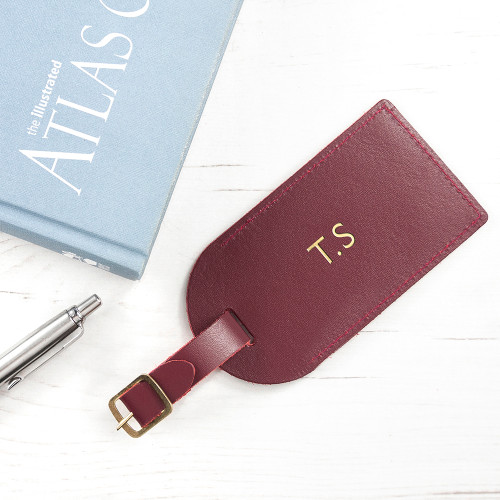 Luxury leather luggage tag with gold buckle, the perfect gift for a professional or a leaving present for the budding traveller!   Personalised with up to three initials which are carefully hand stamped with metallic gold, adding a touch of luxe.  Made from genuine leather.
