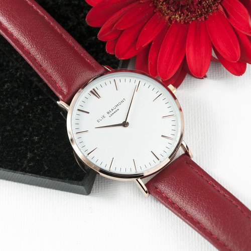 These beautiful modern-vintage watches by Elie Beaumont are carefully personalised by our craftsmen to create the ultimate gift for her.  Elie Beaumont watches are modern in design but with classic, timeless touches - making them a gift that will stand the test of time. Made from genuine leather and with a large 38mm dial with rose gold details this watch certainly makes a statement.  Personalise the watch on the reverse with a message up to 5 lines. The message is carefully engraved onto the back of the watch, meaning your special message will forever be remembered.  The watch is beautifully presented in Elie Beaumont's trademark gift box and leather watch protector. Movement: Miyota (Japanese) Water Resitant: 3ATM Case Width: 38mm Case Depth : 6mm Band Material: Stainless Steel Clasp Type: Fold-over Clasp Guarantee: 2 Years  Ladies watch.