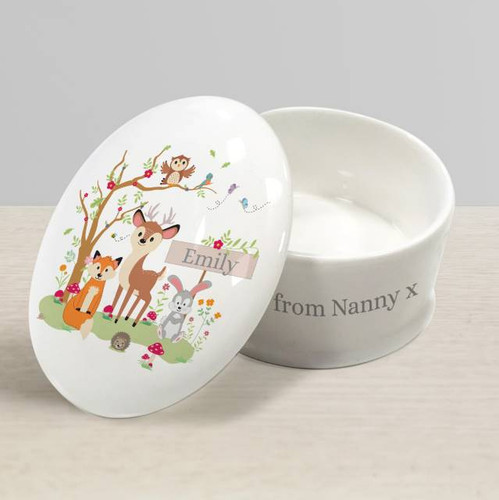 This white bone china trinket box makes the perfect keepsake for that special occasion. The lid features a cute woodland scene with the recipient's name of up to 15 characters. Your personalised message of 50 characters runs around the body of box. It would make a fabulous gift for a little ones christening or 1st birthday, and is a wonderful memento of the big day that will look superb displayed in any home. Kiln fired, this bespoke trinket box is dishwasher safe.