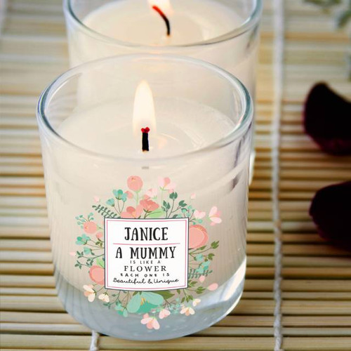 Personalise this rose scented glass candle with a name of up to 15 characters and their title (15 characters). The quote reads '{Name} A {Title} is like a flower each one is beautiful & unique'. The lovely sentiment is written in a white square surrounded by delicate flowers making this the perfect gift for any occasion. Dimensions: 8.5cm tall and 8cm diameter.