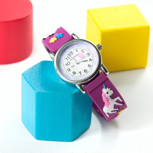 Telling the time has never been so fun with this unicorn themed personalised watch!  Whether it's their first watch, a way to commemorate a special achievement or event in their life - this personalised watch is a wonderful gift.  Made from durable, soft rubber and hardwearing stainless steel meaning not only is the watch able to withstand the rough and tumble of everyday child play but is also comfortable and gentle on their precious skin.  The face of the watch makes telling the time simple, with 'to' and 'past' on the left and right hand side - helping little ones become mini time telling geniuses!  Our watches come with a 12 month guarantee for peace of mind.  Personalise the watch with a message which will be engraved onto the back of the watch.  Beautifully presented in a gift box.  Watch face - 2.7cm  3ATM water resistant Japanese movement Moving symbol second hand