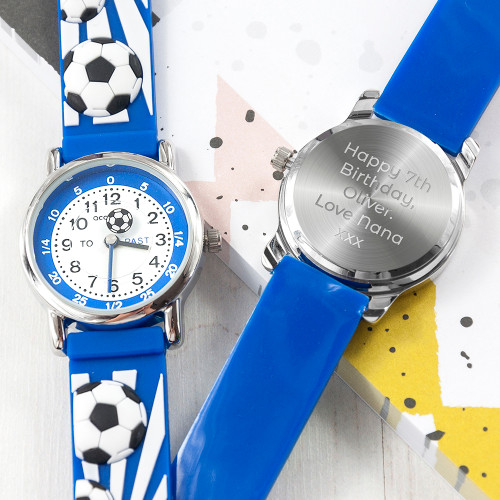 Telling the time has never been so fun with this football themed personalised watch!  Whether it's their first watch, a way to commemorate a special achievement or event in their life - this personalised watch is a wonderful gift.  Made from durable, soft rubber and hardwearing stainless steel meaning not only is the watch able to withstand the rough and tumble of everyday child play but is also comfortable and gentle on their precious skin.  The face of the watch makes telling the time simple, with 'to' and 'past' on the left and right hand side - helping little ones become mini time telling geniuses!  Our watches come with a 12 month guarantee for peace of mind.  Personalise the watch with a message which will be engraved onto the back of the watch.  Beautifully presented in a gift box.  Watch face - 2.7cm  3ATM water resistant Japanese movement Moving symbol second hand