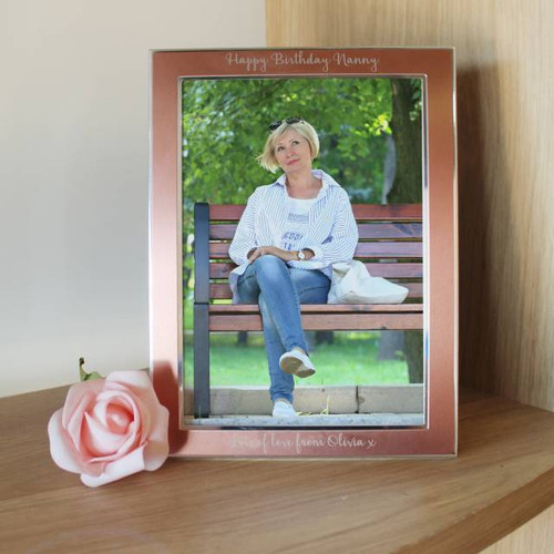 """Holding a 5""""x 7"""" photo, this elegant Rose Gold photo frame would add style to any room. Personalise with a message of your choice, up to 60 characters, to give as a gift or as a treat for yourself. Product dimensions: 20cm x 15cm"""