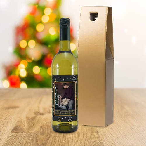 Giving a bottle of wine for a special occasion is a popular concept but now you can take the idea further. Our personalised bottle of French sauvignon blanc features a photo of your choice inside a festive border. You can add a unique message over two lines of 30 characters below. The bottle is presented in a gold gift box filled with red stuffing ready to give to the recipient. Box Dimensions 38 x 9.5 x 9.5cm.