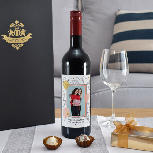 Giving a bottle of wine for a special occasion is a popular concept but now you can take the idea further. Our personalised bottle of French merlot features a photo of your choice inside a quaint border. You can add a unique message over two lines of 30 characters below. The bottle is presented in a gold gift box filled with red stuffing ready to give to the recipient. Box Dimensions 38 x 9.5 x 9.5cm.
