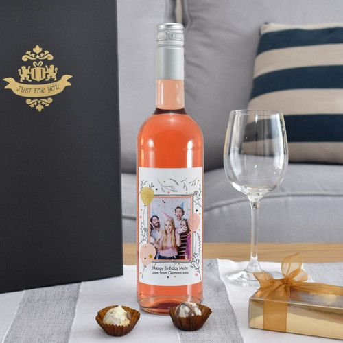 Giving a bottle of wine for a special occasion is a popular concept but now you can take the idea further. Our personalised bottle of French rosé features a photo of your choice inside a quaint border. You can add a unique message over two lines of 30 characters below. The bottle is presented in a gold gift box filled with red stuffing ready to give to the recipient. Box Dimensions 38 x 9.5 x 9.5cm.