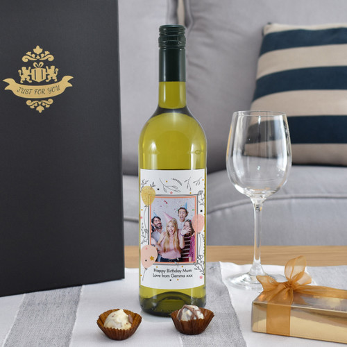 Giving a bottle of wine for a special occasion is a popular concept but now you can take the idea further. Our personalised bottle of French sauvignon blanc features a photo of your choice inside a quaint border. You can add a unique message over two lines of 30 characters below. The bottle is presented in a gold gift box filled with red stuffing ready to give to the recipient. Box Dimensions 38 x 9.5 x 9.5cm.
