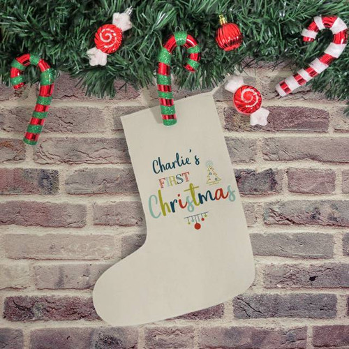 A baby's first Christmas is definitely a landmark to be celebrated. The magic of their first Christmas can always be treasured with this colourful stocking. Personalise with a name of 15 character. Made from 170gsm cotton, the stocking measures 57cm tall and 28cm wide, fully finished and with a hanging loop. Please note: 'First Christmas' is fixed text.