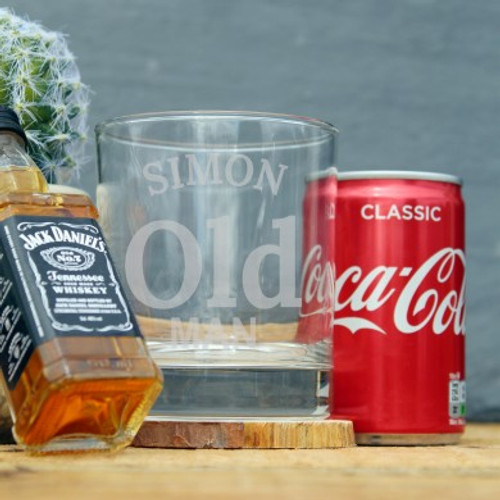 Personalise this dad themed gift set with a name of up to 15 characters above the fixed text ' Old Man'. The set consists of a personalised tumbler, a 50ml Jack Daniels and a 100ml of classic Coco-Cola. Tumbler dimensions: 9 x 7 x 7 cm. The glass is dishwasher safe.
