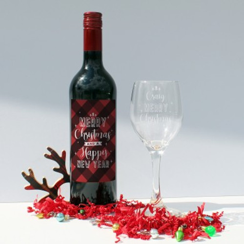 Say Merry Christmas with this personalised gift set. Add a name of up to 15 character to the wine glass above the fixed text 'Merry Christmas'. 'Merry Christmas and a Happy New Year' is printed in white on a red checked label which is featured on the bottle of wine. The set is presented in black silk lined presentation box. Glass Dimensions: H 20cm, W 7cm, D 7cm. Box Dimensions H 10cm, W 20cm, D 34cm.The glass is dishwasher safe.