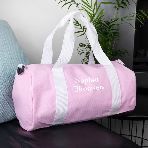 This stylish canvas bag that doubles as a gym kit bag or a handy carry-on for the little ones, has a roomy main compartment in which their football kits and shoes can be stored into. There'sa small outside pocket that can store keys to lockers, their phones or pocket change.   The shoulder strap that stretches from 70 cm to 120 cm, and is 4 cm wide, can help the bag alternate between being hand-held and slung over their shoulder, while ensuring that it's never too heavy to carry.  Personalise it with their name and surname to make it their very own - and potentially, to stop some friendly sibling rivalry too!