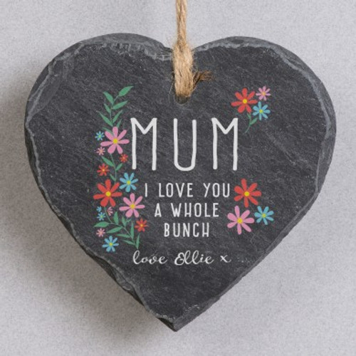 Personalise this hanging slate heart sign with your loved one's title using a maximum of 15 characters. You can also add your name/s using 15 characters which will appear below the fixed text '{Title} I love you a whole bunch. Love'. The slate measures 20cm high, 20cm width and 1cm depth complete with hanging rope.