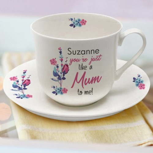 Personalise this beautiful white bone china cup and saucer with your loved one's name using a maximum of 15 characters. This will be fired above the fixed quote 'You're Just Like A Mum To Me!' Dimensions: Saucer 18cm diameter. Cup: 9cm tall, 14cm wide (Inc. handle) and 11cm depth.