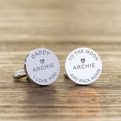 """High quality silverplated round cufflinks. The first cufflink is engraved """"DADDY I or WE LOVE YOU..."""". The second cufflink is engraved """"... TO THE MOON AND BACK AGAIN"""", just add a name or names to complete the design. If you require the same childs name on both cufflinks please enter the name in both engraving fields below. Supplied in a smart cufflink case."""