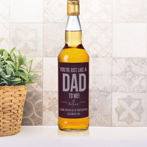 Treat someone who is just like a dad to you with this personalised bottle of single malt whisky. Personalise the label with a name of up to 15 characters below the fixed quote 'you're just like a Dad to me'. Add your special message below over 2 lines of 30 characters. The bottle is presented in a gold gift box filled with red stuffing ready to give to the recipient. Box Dimensions 38 x 9.5 x 9.5cm.