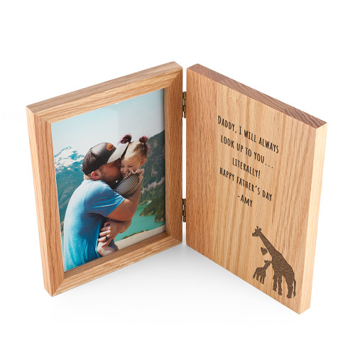 """Made with remaining oak offcuts, from FSC sourced wood, this beautiful book style frame is a gift to always treasure! Fitting photos of 7"""" x 5"""", the glass will cover and protect the photo from dust, while the book style opening makes it a great frame to have on a night stand, or to keep on a mantle in the living room.  While the text comes as standard, sign it off with your own name, to let Dad know who the gift is from and who's admiring them this Father's Day."""