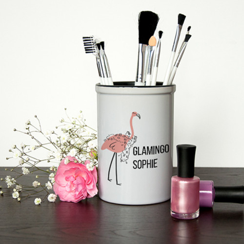 The ULTIMATE gift for the glamorous person in your life - a ceramic glamingo pot that holds their many tools and brushes that help them to look this fab. Personalise the gift with their own name.