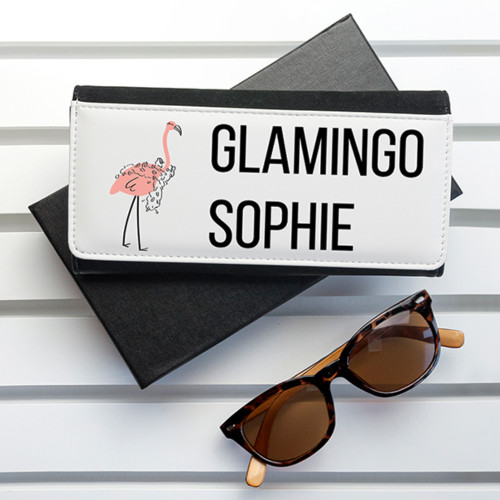 This fun and vibrant flamingo themed wallet is a special gift for the friend who's always 100% glam and fab, for the friend who always has your back. The purse itself is made from PU leather and opens up with space for notes, coins and 5 bank card holders - plenty of room to hold everything she needs.
