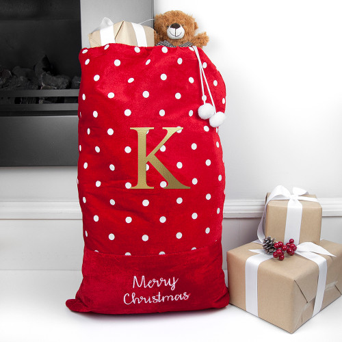"""A polka dot santa sack? A stylish santa sack for the home with the standard """"Merry Christmas"""" text across the bottom of it. It can be personalised with a name acroos the middle of it."""