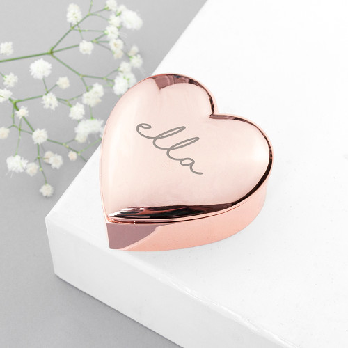 This small, compact heart trinket box comes in either rose gold or silver, with a plush black felt interior to protect any small jewellery from scratching.  It's ideally suited to take while travelling, or to have as an item on her nightstand, vanity table.  Personalise with a name.