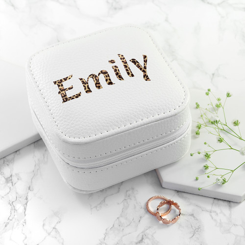 This white leather case is perfect travelling kit in which to keep all your precious jewellery in. Securely closing with a zip and with a grey suede-like interior, the interior boasts space for rings, necklaces and earrings, complete with a little mirror.  At 12 x 9 cm in size it's an ideal gift for jet setters and travellers, however if you know someone who treasures few key pieces of jewellery, it can sit as a keepsake on her night stand or vanity table.  The design features a choice between a zebra or leopard animal print to additionally personalise the name with.