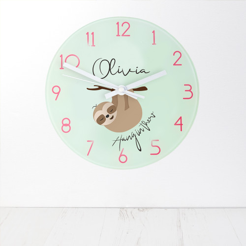 For the one that needs motivating!  This cute sloth-themed wall clock is a perfect gift for those who love sloths and cute animals.  This 20cm glass wall clock is great to hang in their bedrooms.  Personalise with a name up to 15 characters.