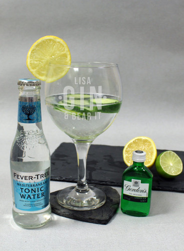 This gin set is the perfect gift for any occasion. The set includes a gin balloon glass, a 5cl bottle of Gordon's gin and a 200ml Fever Tree Mediterranean tonic water. Personalise the gin balloon glass with a name of up to 15 characters above the fixed text 'Gin & Bear It'. Glass Dimensions: H 20cm, W 11cm, D 11cm. The glass is dishwasher safe.