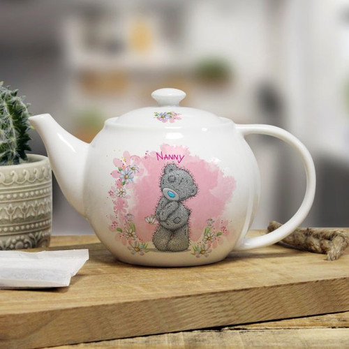 Personalise this lovely Me to You floral themed 25oz teapot with a name of up to 15 characters on the front above the adorable Tatty Teddy. You can also add a message on the reverse over 4 lines of up to 20 characters. Dishwasher and microwave safe. The teapot measures 11cm high, 20cm width and 12cm depth.