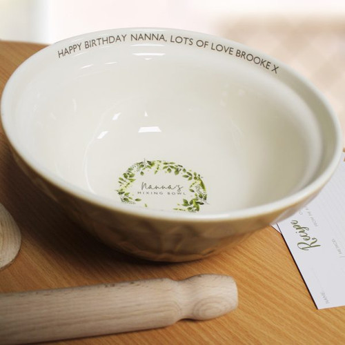 This is the perfect gift for any baker! This traditional Mason Cash bowl has an added modern twist. Your baker's name is fired onto the base of the bowl before the fixed text ' 's Mixing Bowl' using up to 15 characters. You can also add a personal message to the rim of the bowl using 30 characters. Dishwasher safe. Dimensions : 24.5 x24.5 x11cm