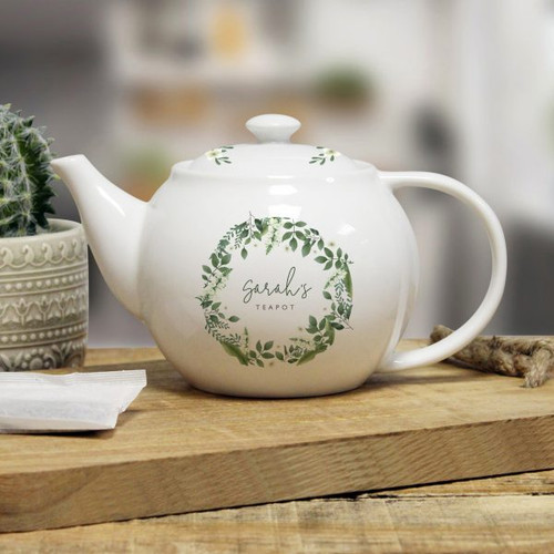 Personalise this lovely floral themed 25oz teapot with a name of up to 15 characters on the front above the fixed text 'TEAPOT'. You can also add a message on the reverse over 4 lines of up to 20 characters. Dishwasher and microwave safe. The teapot measures 11cm high, 20cm width and 12cm depth.