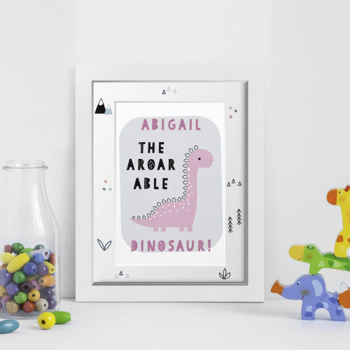 Personalise this cute dinosaur framed print with a name and colour. Your chosen name will appear at the top of the print above the fixed text `The Aroarable Dinosaur;. The frame is 34.5cm tall, 25.5cm wide and 1.5cm thick with an easel back. The print inside is 9″ x 6″.