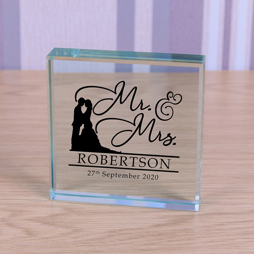 The perfect gift for the new Mr & Mrs. Made from premium glass it looks stunning as an ornament but can also be used as a paperweight. Personalise with a name and date / message to make a beautiful gift and keepsake. Supplied in a lovely organza gift bag. (Size 80 x 80 x 20mm)