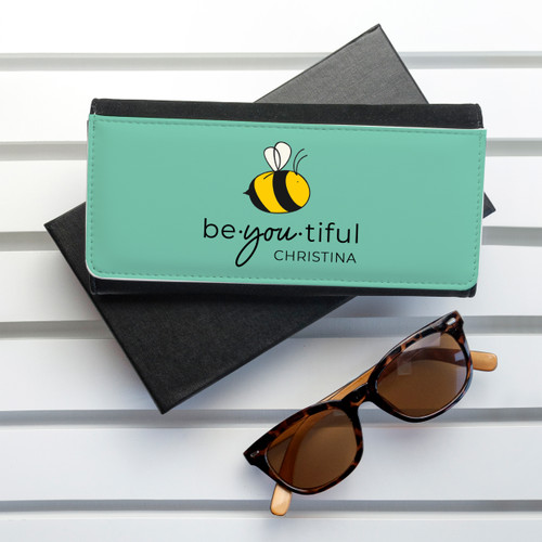 """Sometimes a little message of encouragement can go a long way in making someone's day, to make them smile, to have them believe in themselves. The appropriately punned """"Bee You"""", complete with a bee design for effect, enahnces this message. The purse itself is made from PU leather and opens up with space for notes, coins and 5 bank card holders - plenty of room to hold everything she needs."""