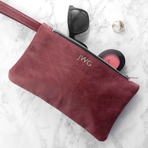 With soft suede interior and handmade in the UK, this leather clutch bag is sure to become a go-to accessory for any occasion. Fitted with a handy pouch, and spacious, you can easily fit your keys, purse, small make up bag and anything else that is a must-have on a night out.  Monogram the bag in either silver or gold characters.
