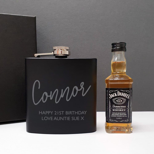 Presented in a black gift box this 5oz black hipflask is engraved with their name and a special message from you over 2 lines of 25 characters. Teamed with a 5cl bottle of Jack Daniels giving them a little tipple to get them started. Dimensions 11.5 x 10 x 3 cm.