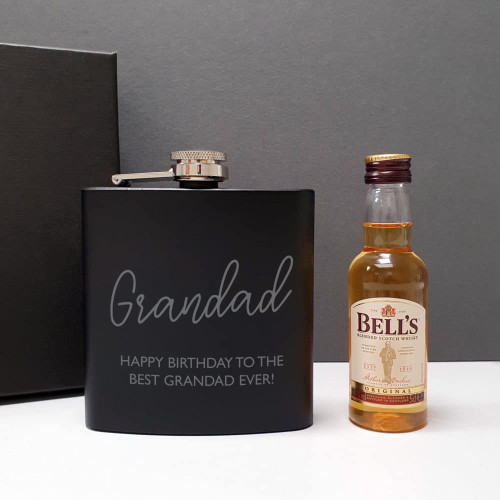 Presented in a black gift box this 5oz black hipflask is engraved with their name and a special message from you over 2 lines of 25 characters. Teamed with a 5cl bottle of Bell's Whisky giving them a little tipple to get them started. Dimensions 11.5 x 10 x 3 cm.