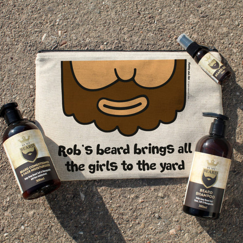 Treat your bearded recipient to their very own beard grooming kit. Personalise the bag with their name of up to 15 characters, this will appear before the fixed Text ' 's beard brings all the girls to the yard.' Inside the 21 x 31cm padded canvas bag is a 300ml bottle of beard conditioner & face moisturiser, a 300ml bottle of beard shampoo and a 30ml bottle of beard oil. All blended from the finest natural ingredients. Light & non-greasy with a subtle, contemporary masculine fragrance. Not tested on animals and suitable for vegans.