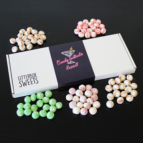 A very grown up sweet treat delivered straight through your letterbox!  The perfect gift for adults who want a cheeky cocktail treat without the alcohol. This great collection of gourmet sweets tastes grown up and fantastic.  The postal box is packed with 5 sweet bags and then sealed with a personalised 'Candy Cocktails' sticker.   • Personalised Postal Box Measuring 35 x 13.5 x 2 cm. • Filled with 5 delicious Sweet bags, Including – Vodka and Cola, Gin and Tonic and Strawberry Prosecco. • Fits through a letterbox. • No Alcohol is used in making these sweets.