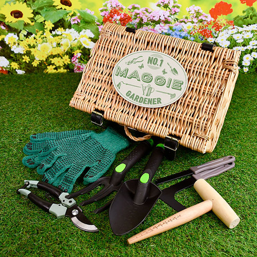 The only gift your green fingered friend will need to make their summertime gardening even more enjoyable. This gorgeous, handmade wicker hamper is adorned with a personalised No.1 Gardener plaque and filled with high quality gardening items to make growing the most beautiful flowers even easier. The Hamper includes useful items including Unisex gardening gloves, Easy grip fork and trowel, A dibber, Plant clips, A weeding tool and a pruning tool!  • Handmade Wicker Hamper measuring 32 x 22 x 11 cm • Personalised plaque attached to hamper. • A fabulous collection of gardening tools.